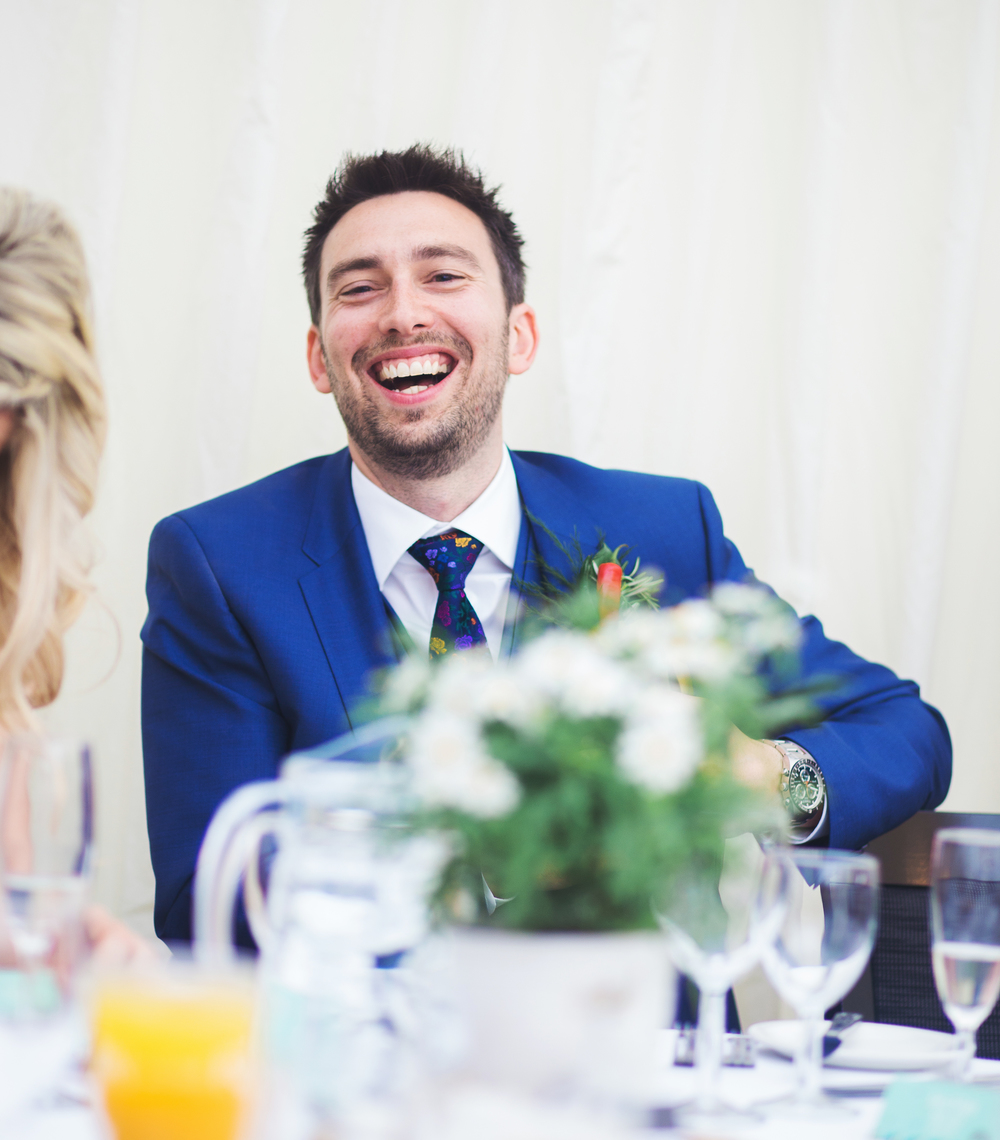 Candid shot of the happy groom.