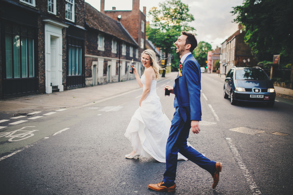 Bride and groom photograph in the streets of York.