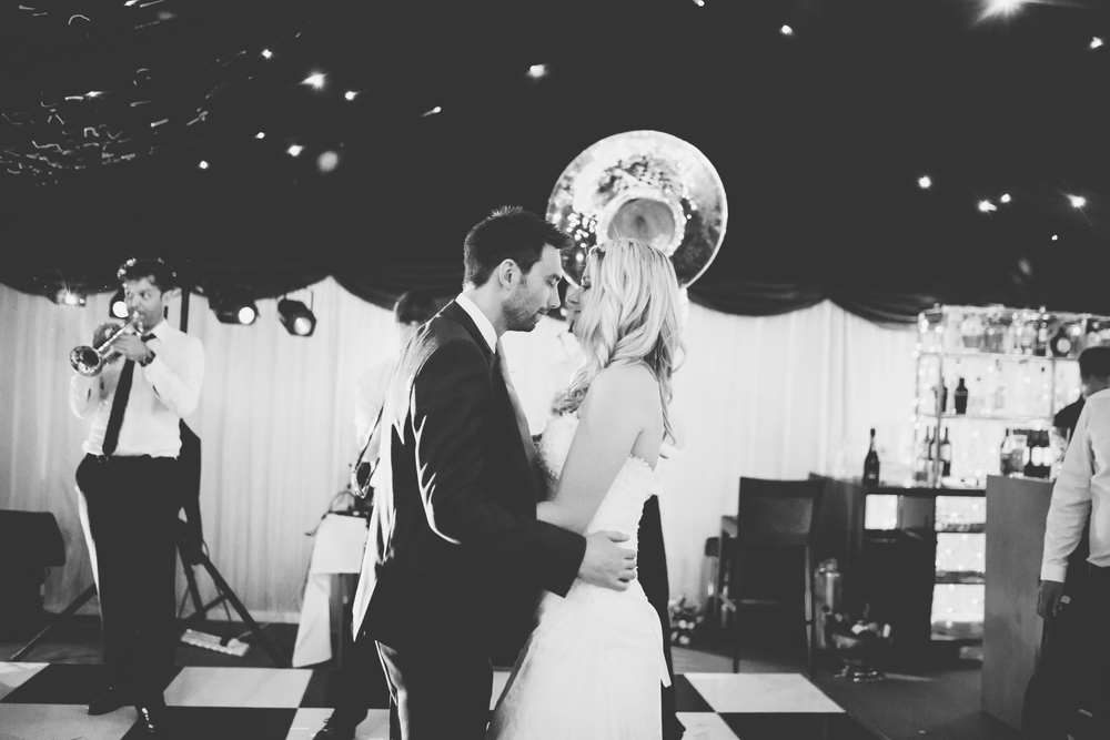 Black and White photograph of the bride and groom. Brass band wedding