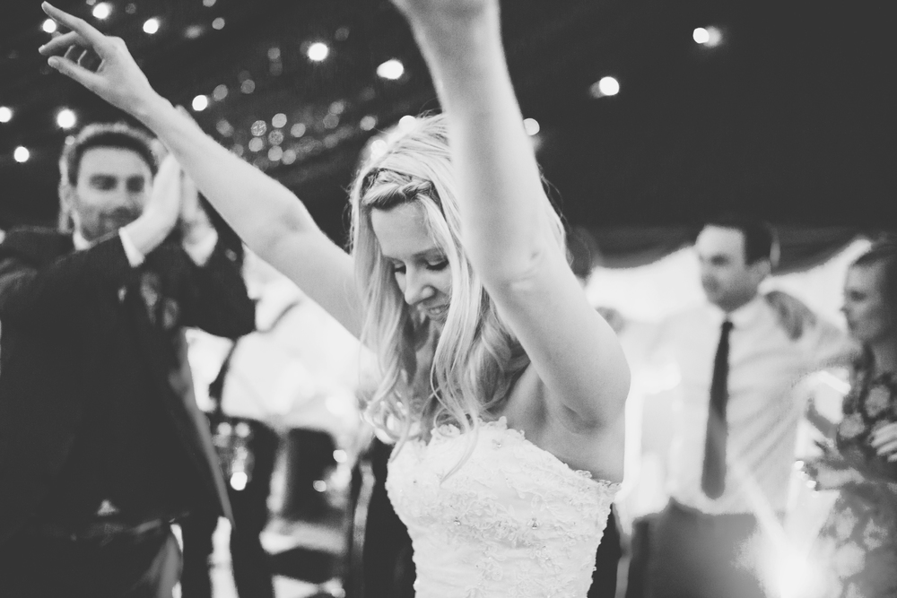Black and white photograph of the bride on the dance floor. Documentary wedding photography in cheshire