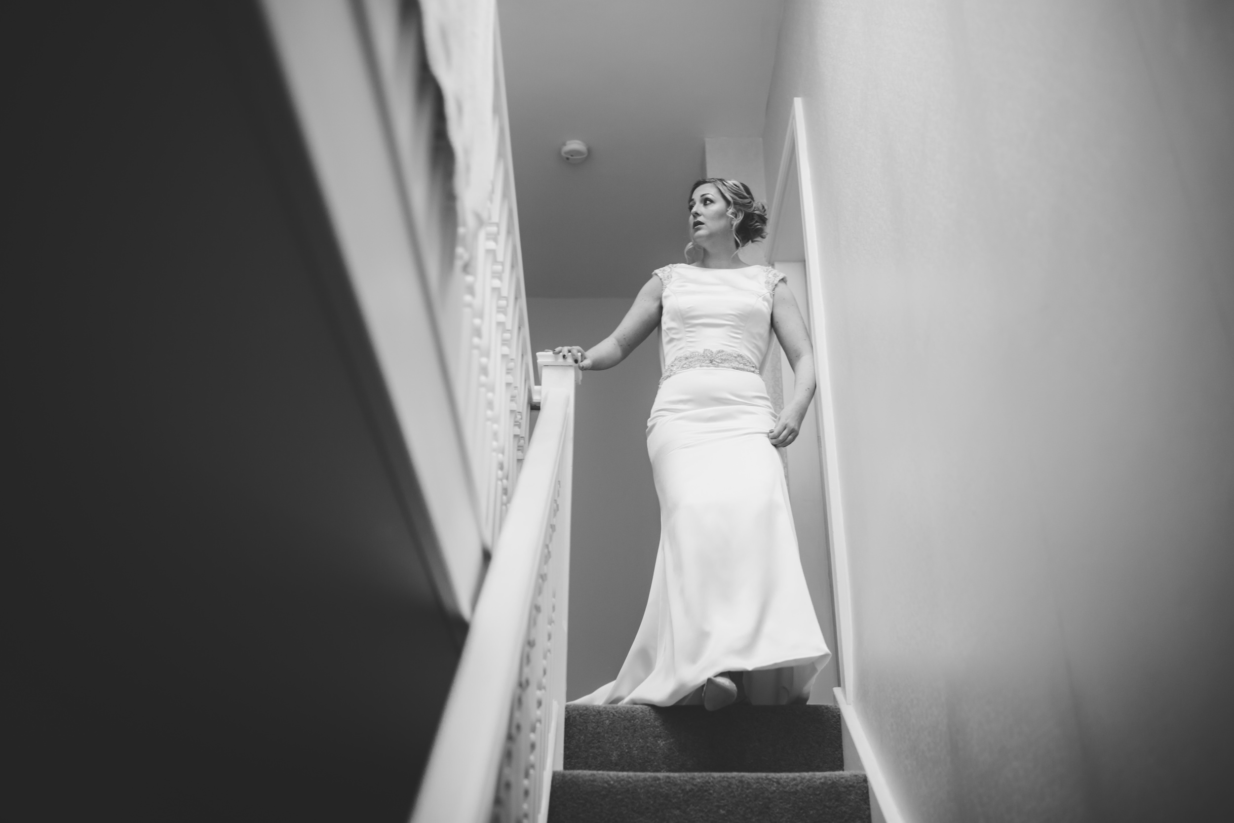 bride walks down the stairs - natural wedding photography