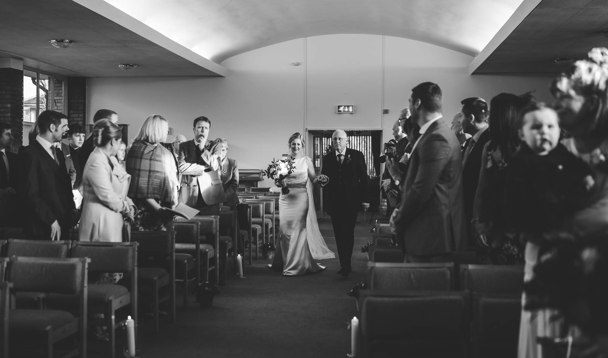 north west wedding photography - bride walks down the aisle