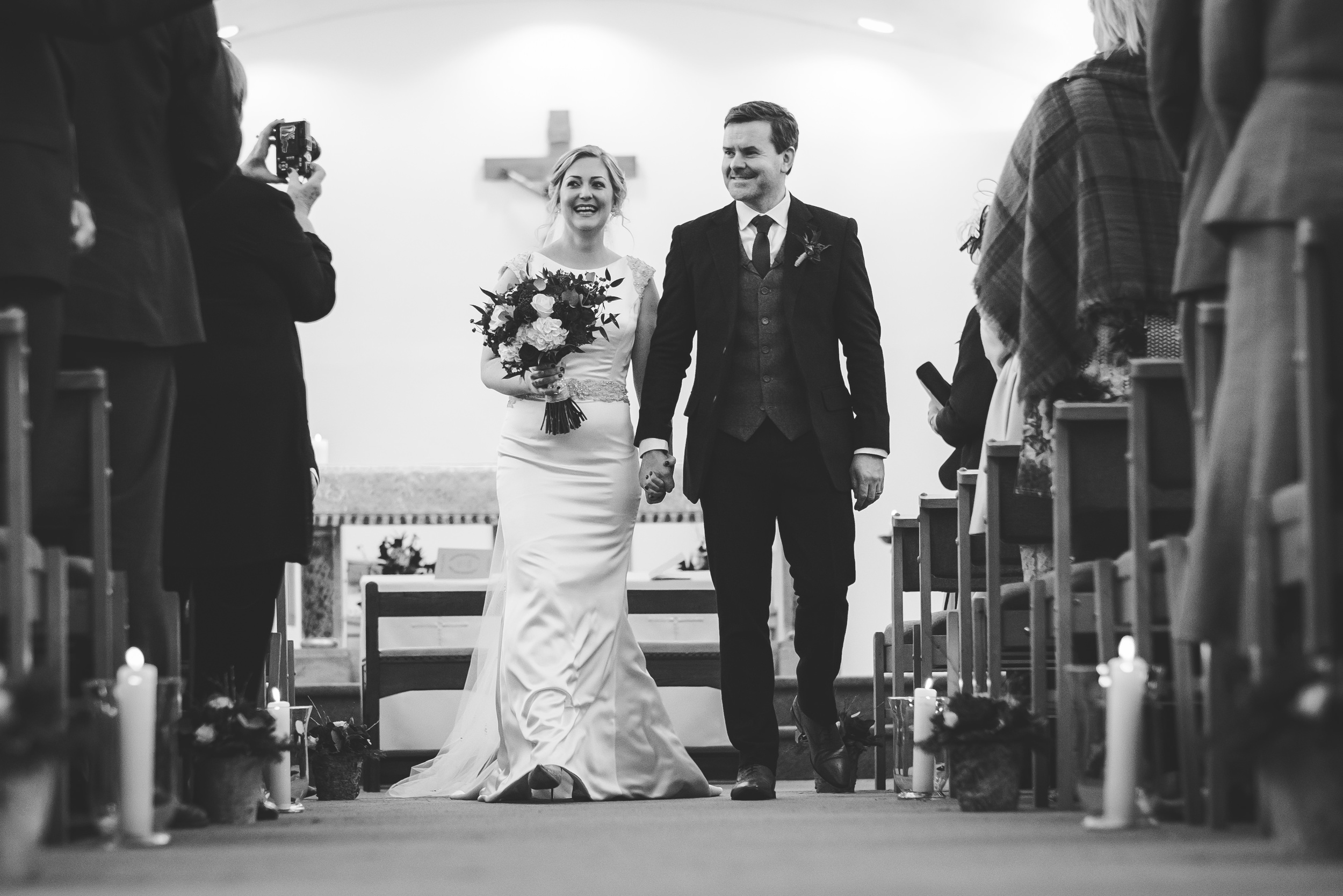 newlyweds walk down the aisle as husband and wife
