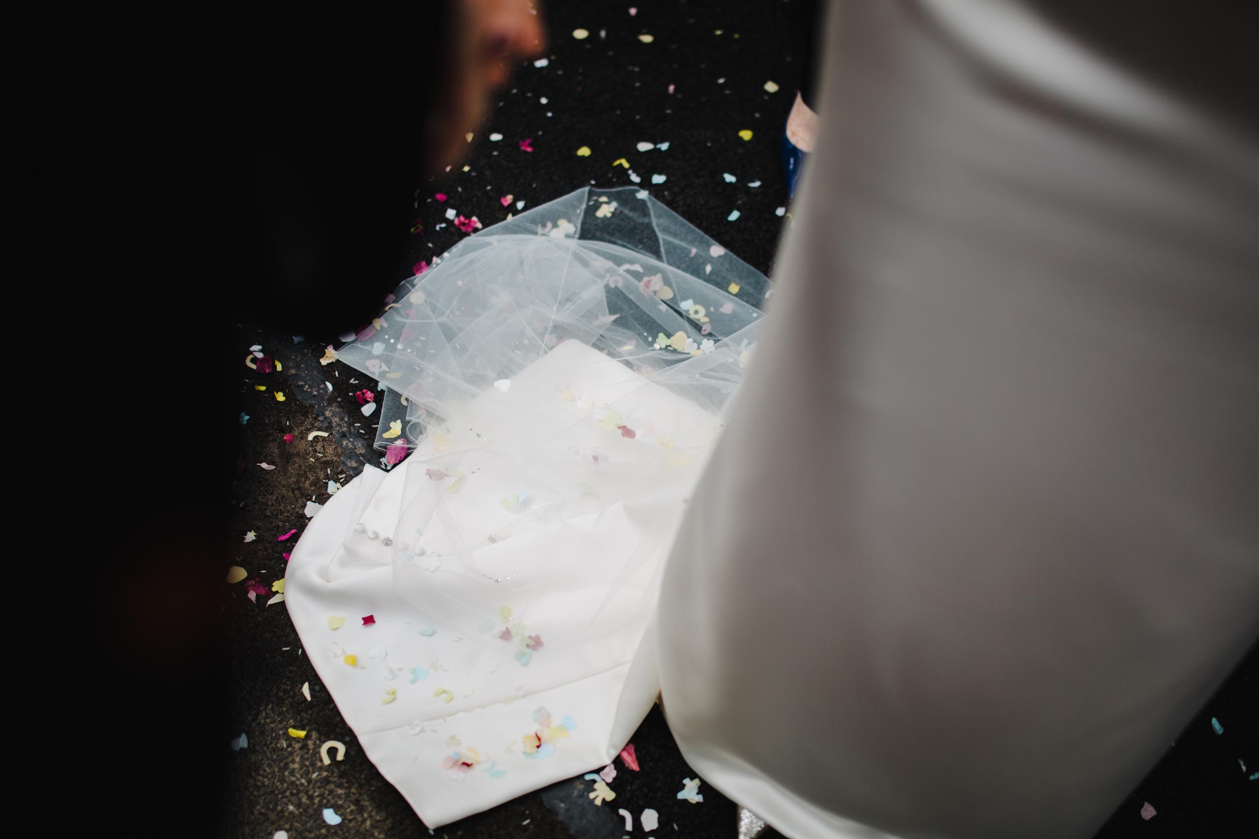 bride's dress covered in confetti