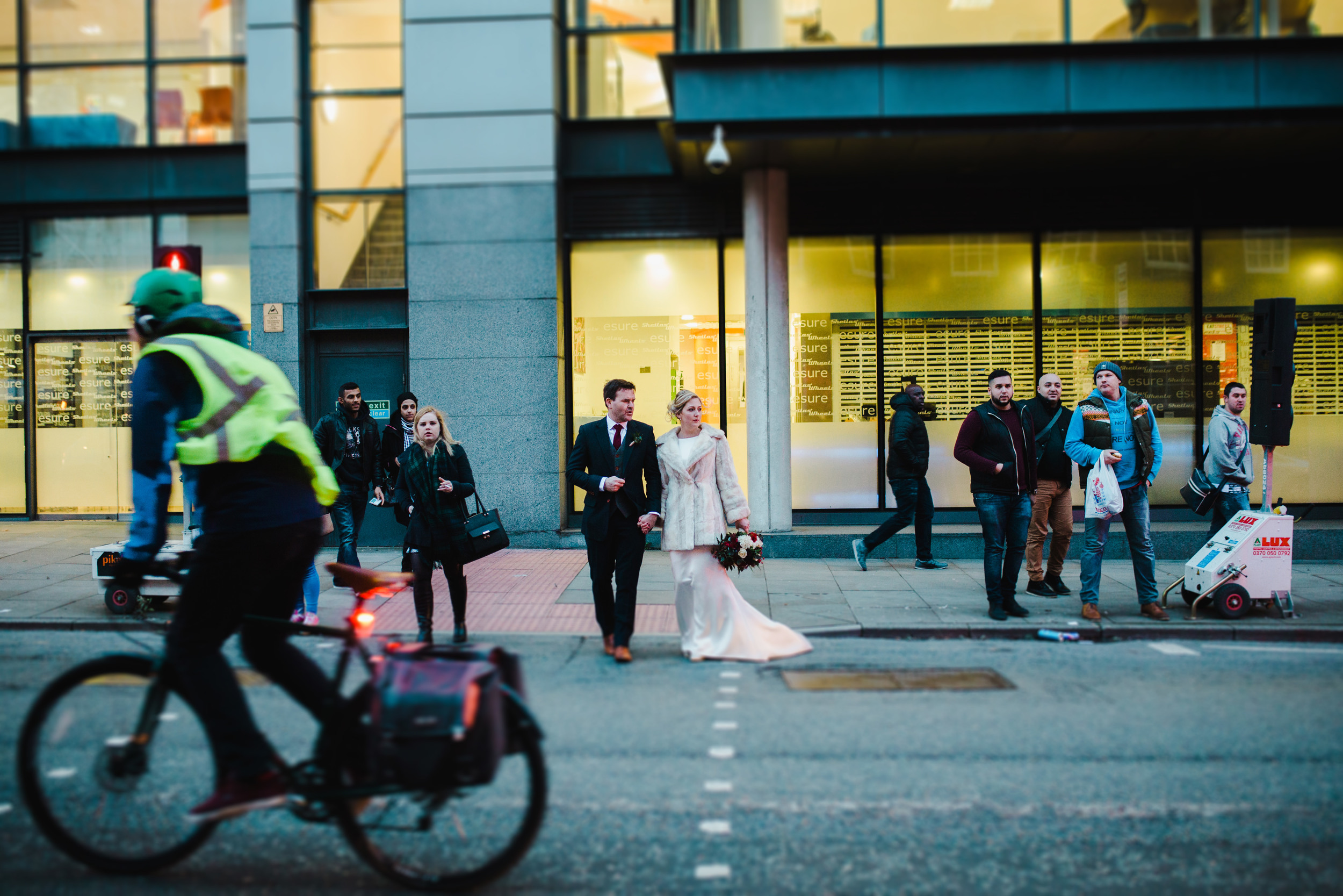 Manchester city centre wedding - bride and groom cross the road