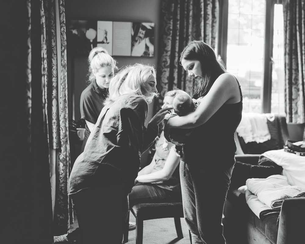 documentary black and white wedding photography of bride and bridesmaids getting ready