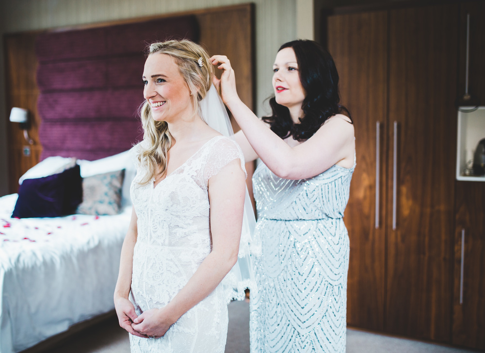In goes the brides wedding veil. Documentary wedding photographer