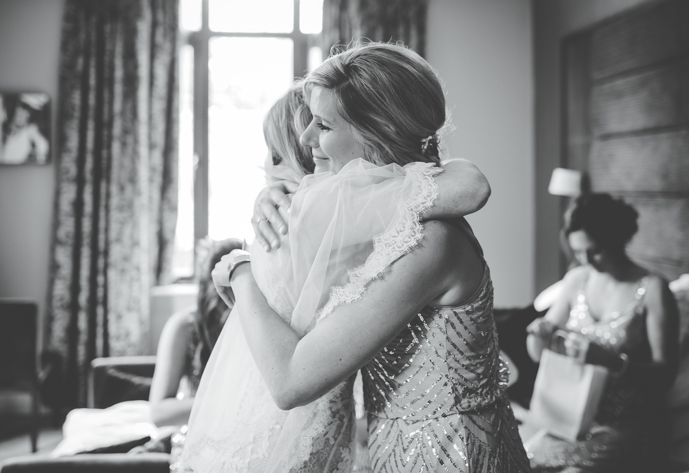 Hugs from the bride- Relaxed Mordern wedding.