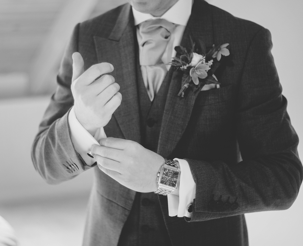 Close up of the groom getting ready