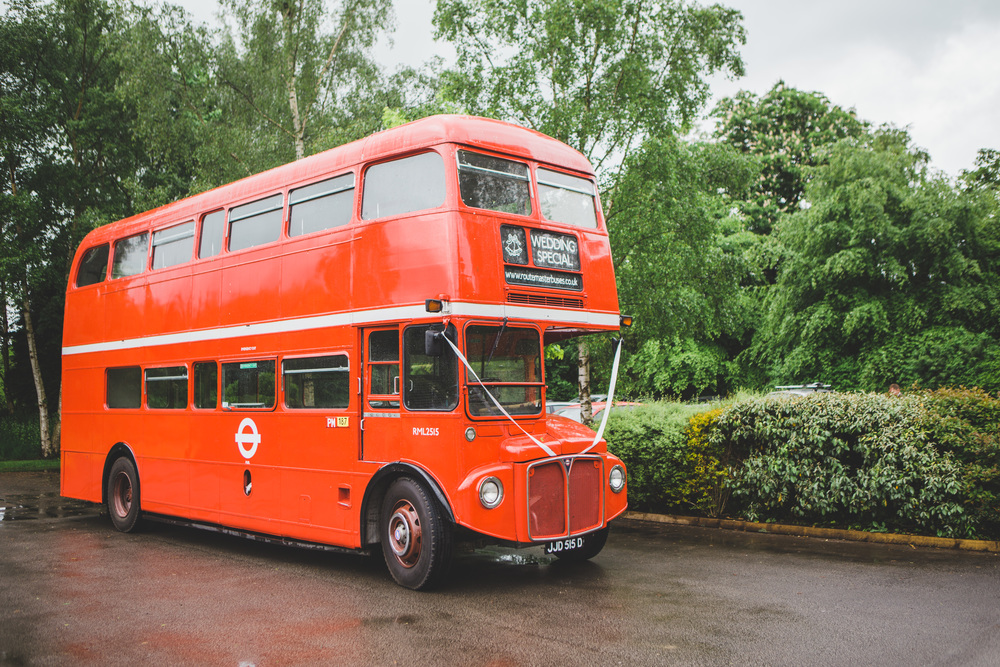 A red double decker bus for a relaxed wedding.