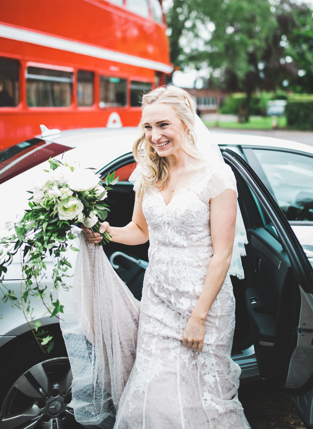 The beautiful bride stepping out of the wedding car at The Oak Tree of Peover.
