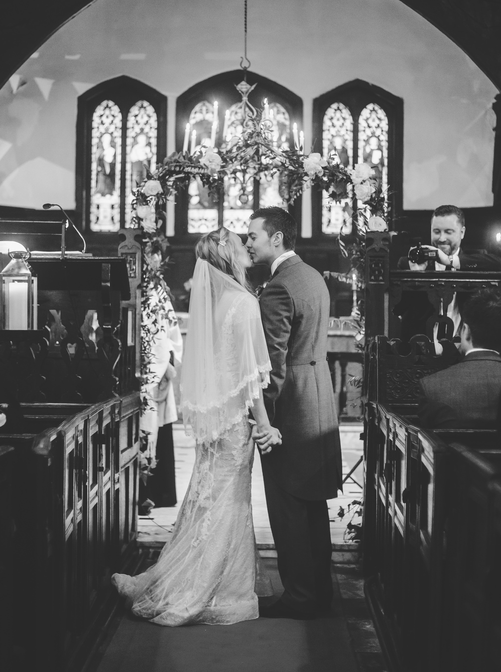 The first kiss for the bride and groom. - Wedding photographer Cheshire