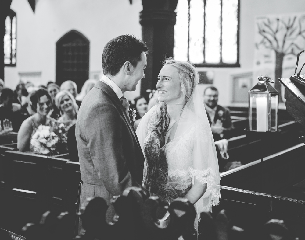 -Cheshire documentary photograph of the bride and groom at the alter.