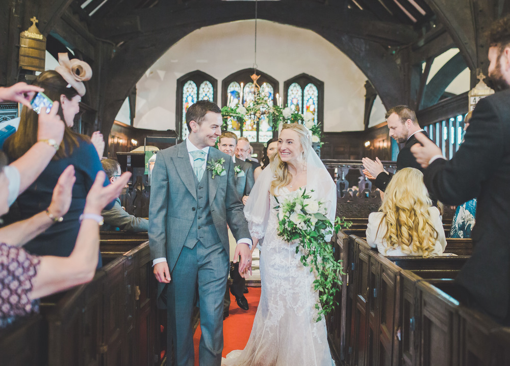 A picture perfect moment of the bride and groom walking back down the aisle. -Cheshire wedding photographer.