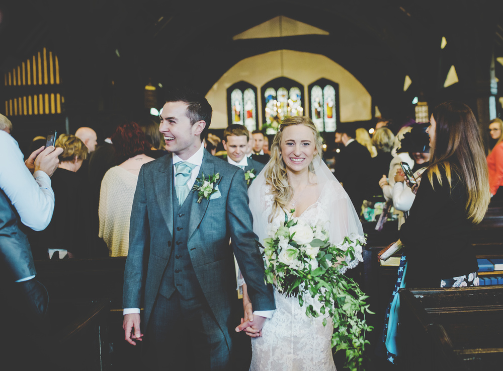 The bride and groom back down the aisle at Oak Tree of Peover.