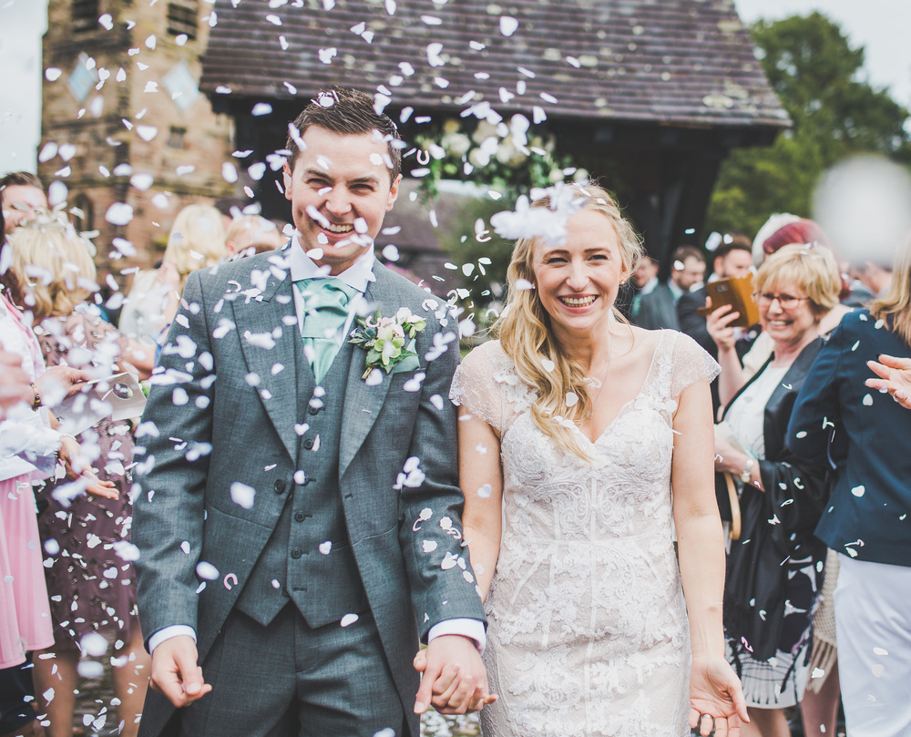 A confetti full photograph for the bride and groom