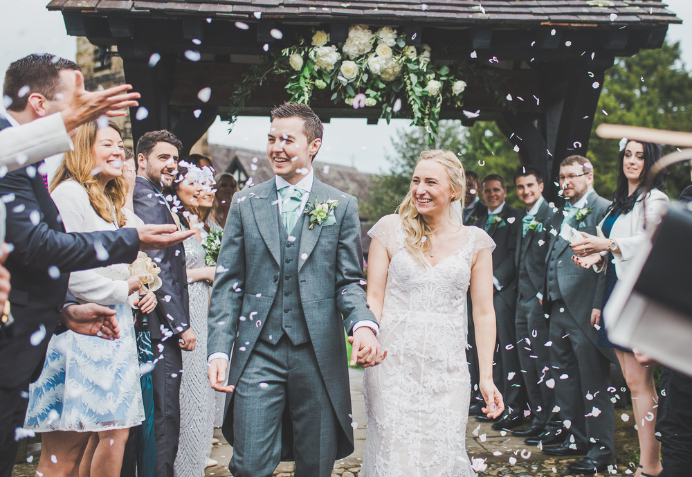 A walk through confetti for the bride and groom. - Wedding photographer