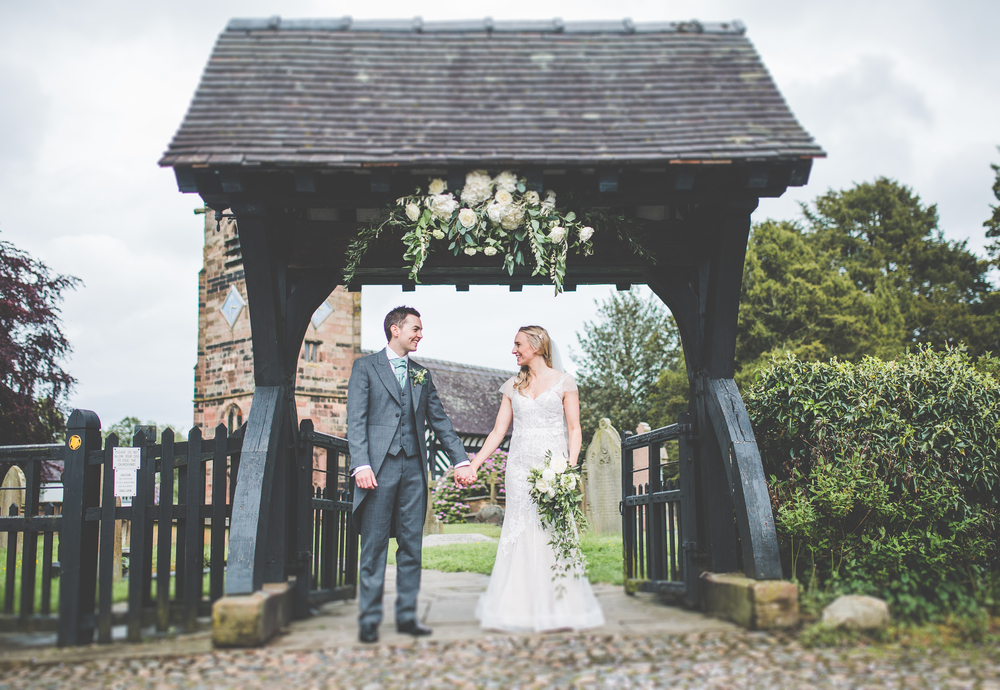 Bride and grrom outside of the church- Cheshire documentary photography.