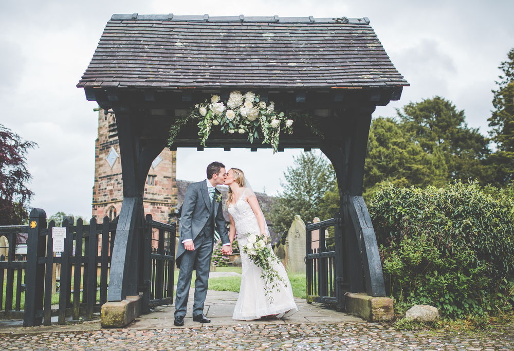 The bride and groom sharing a kiss in Cheshire after the wedding.