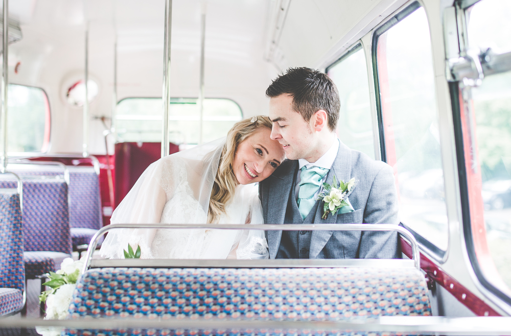 The bride and groom sat on the wedding guest bus.- Creative wedding photography