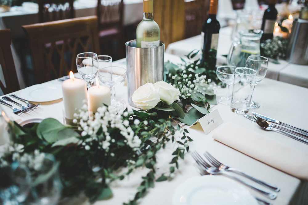 Simple yet elegant table arrangement. Wedding photography.
