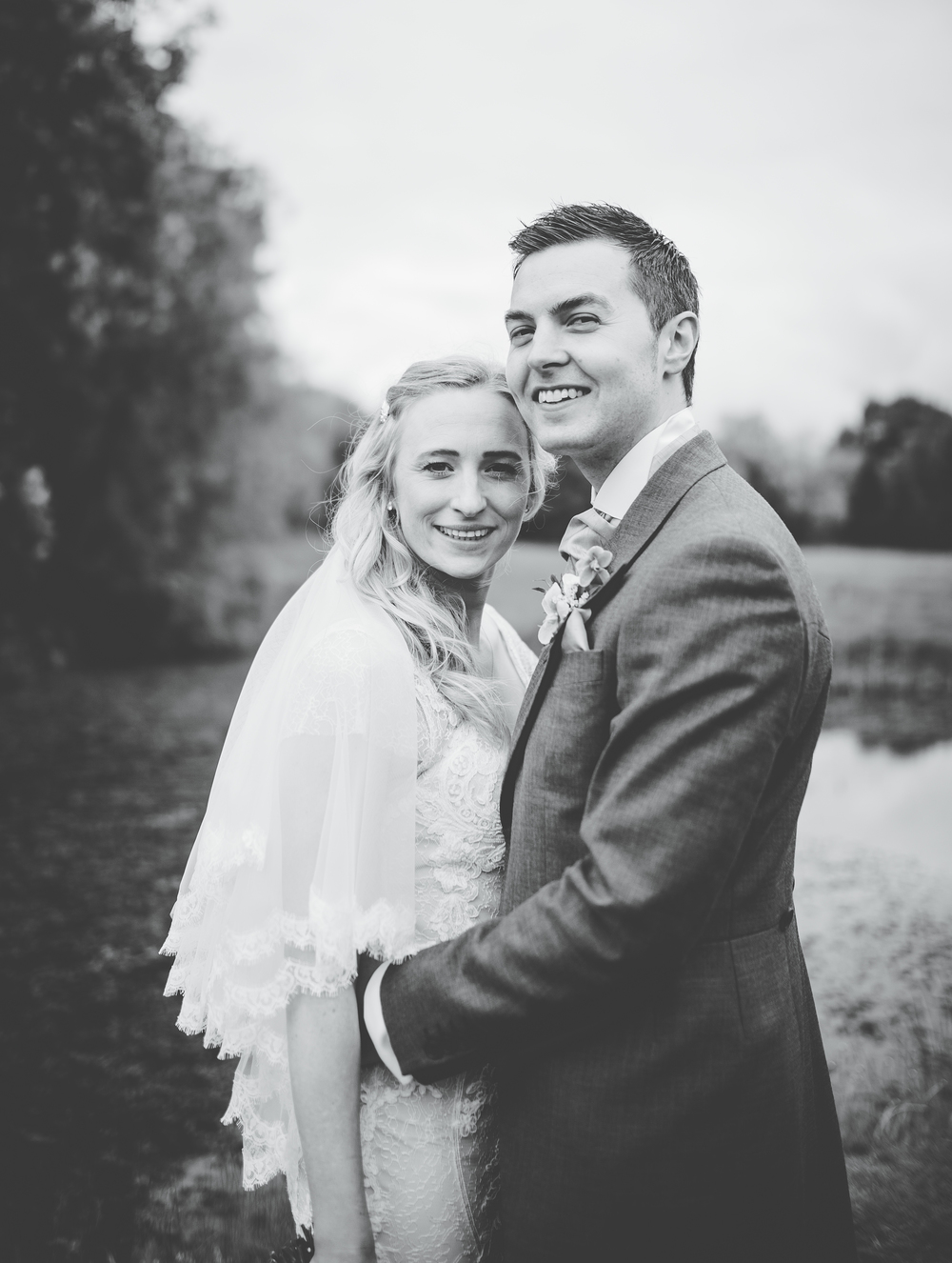 Black and white photo of the bride and groom smiling. Creative photography.