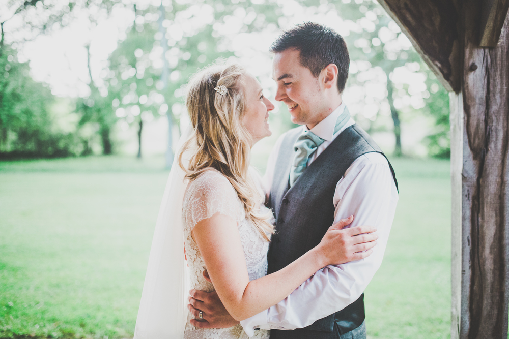 The bride and groom looking into one another eyes. - Creative wedding photographs