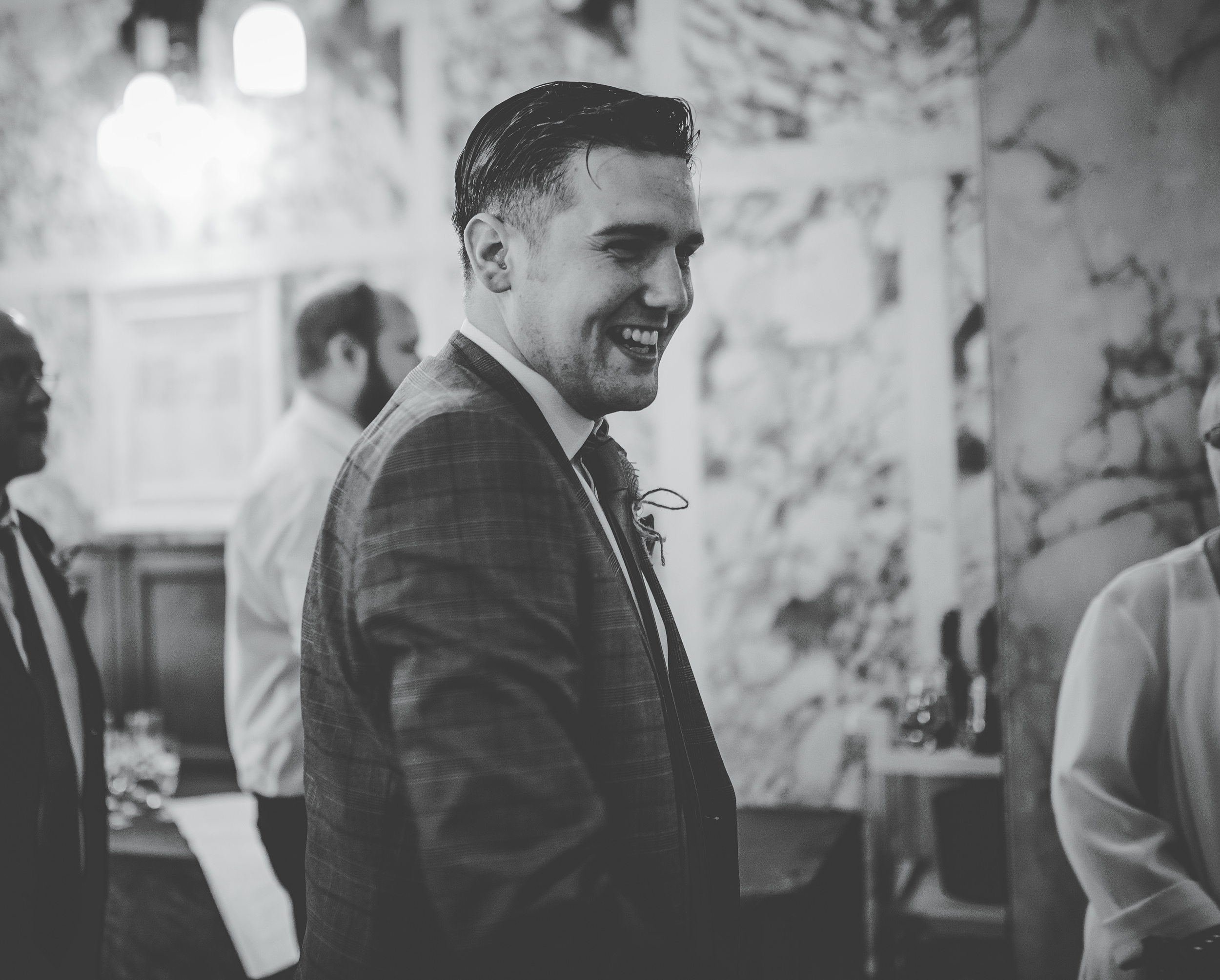 groom greets guests at Stockport Town Hall