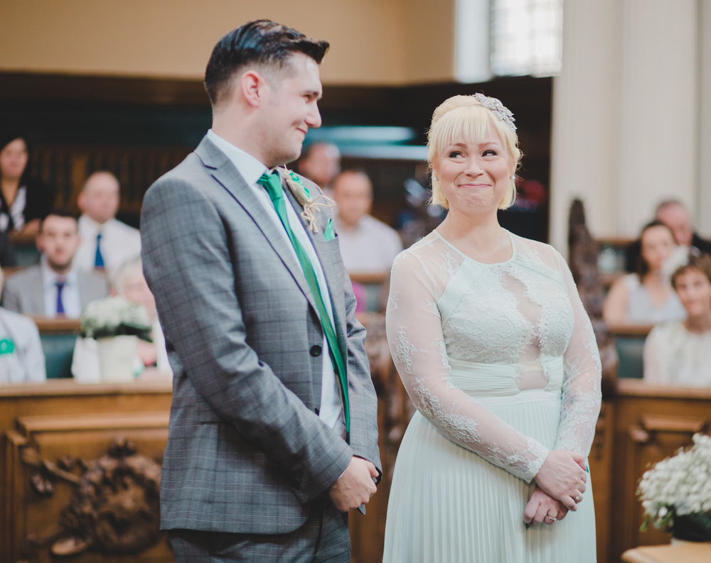 The beautiful bride and groom during the wedding ceremony at Stockport Town Hall
