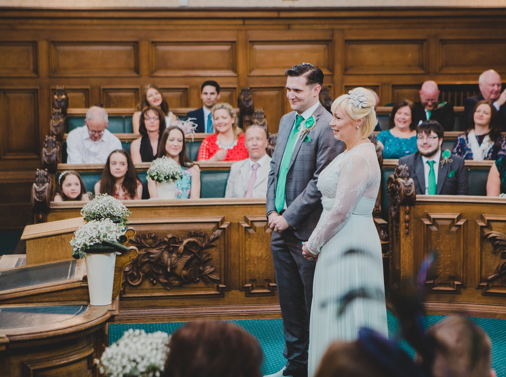 The bride and groom side by side at Stockport Town Hall.