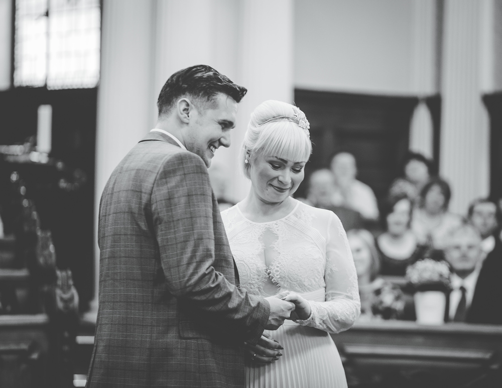 The bride and groom saying their vows at Stockport Town Hall.