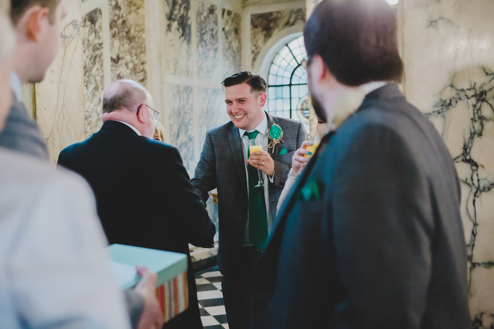 The groom surrounded by his wedding guests-Stockport Wedding Photography.