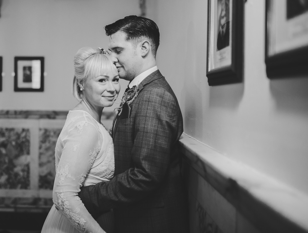 Portraits of bride and groom at stockport town hall - creative wedding photography