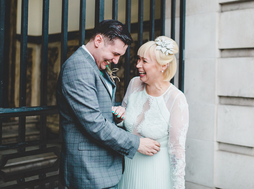 Giggles from the bride and groom- Stockport Documentary Photography.