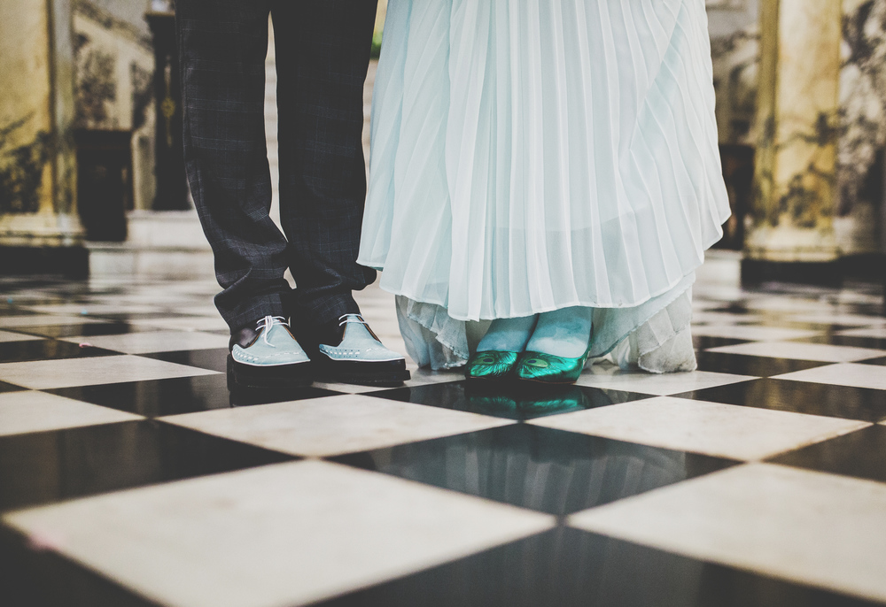 The bride and grooms shoes on the checkered floor in Town Hall, Stockport.