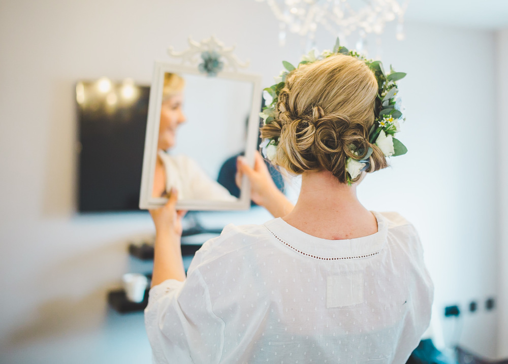 The brides hair from behind. Vintage themed wedding