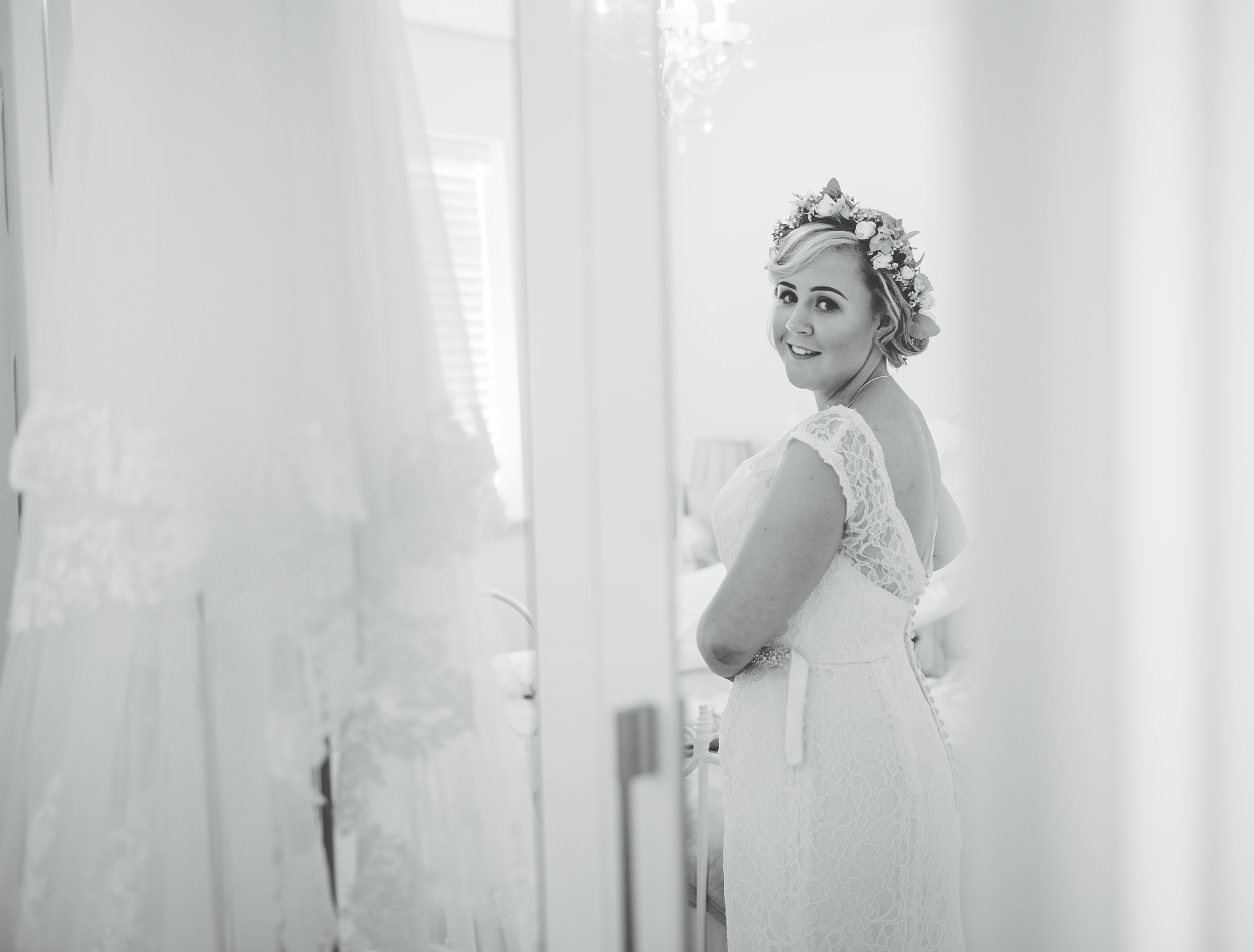 bride getting dressed - natural wedding photography