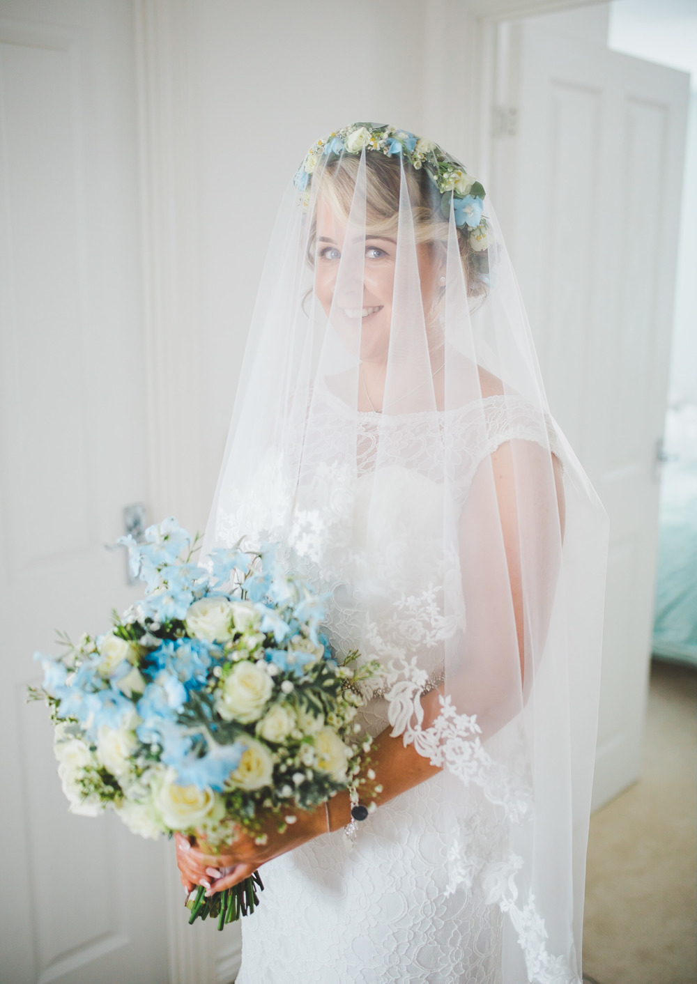 The bride in her veil -relaxed wedding photography