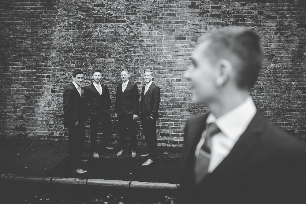 The groom and his groomsmen before his wedding at Gorton Monastery