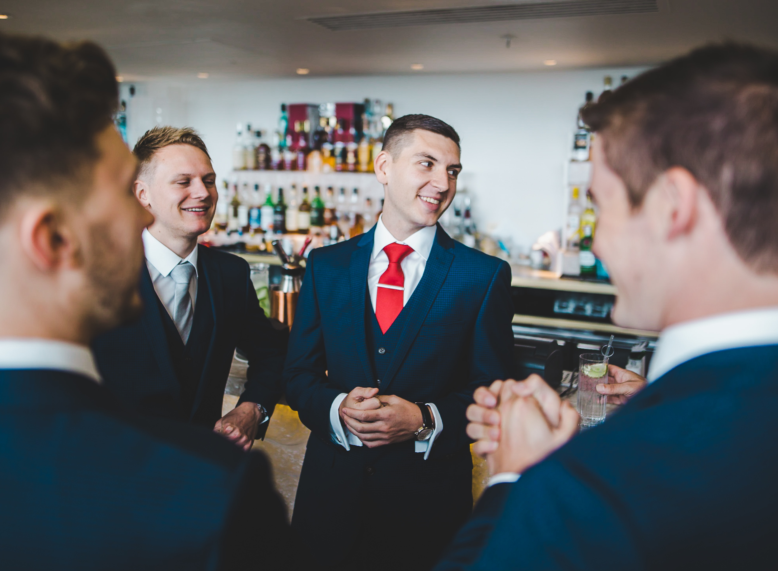 groom at bar - north west wedding photography
