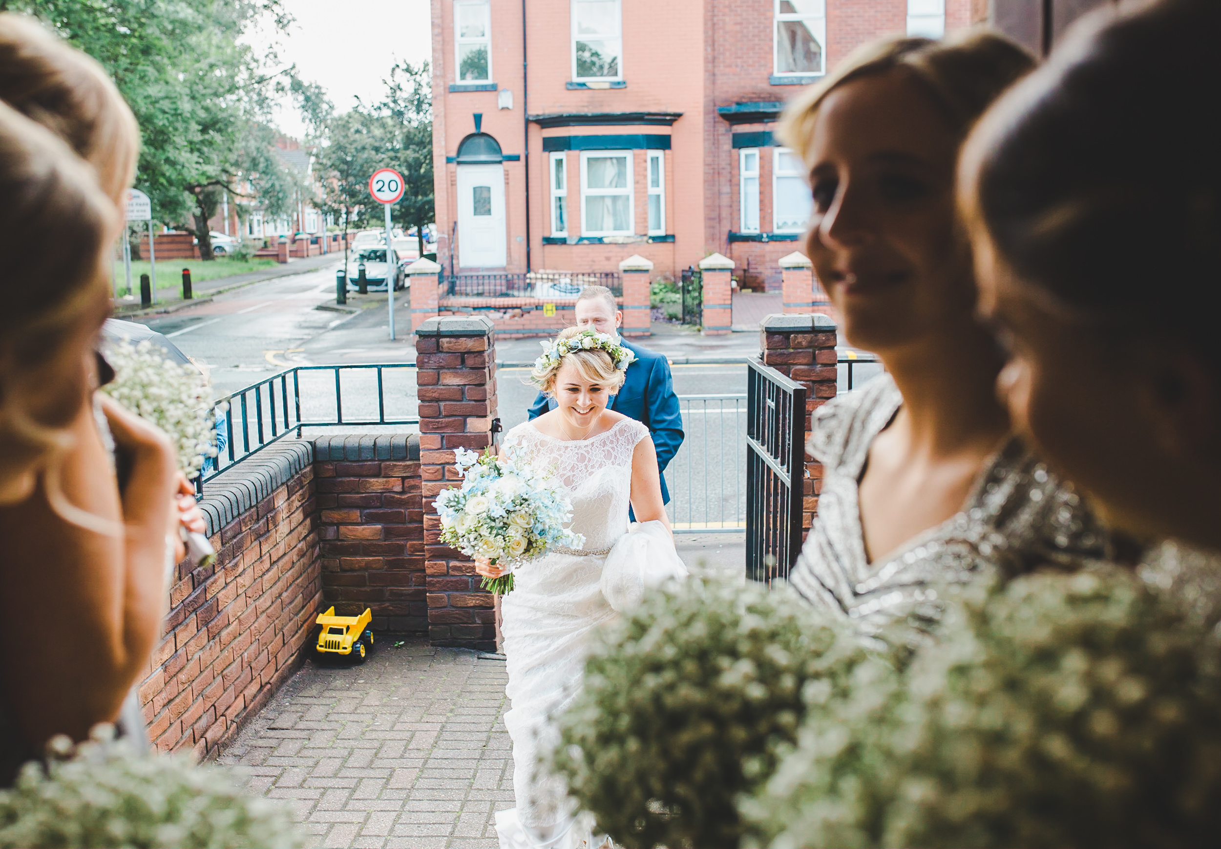 bride walks into church - wedding photographer north west