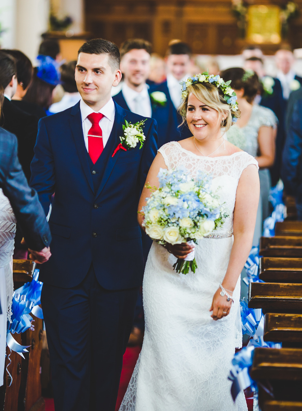 The bride and groom walking back down the aisle- Documentary wedding photographer