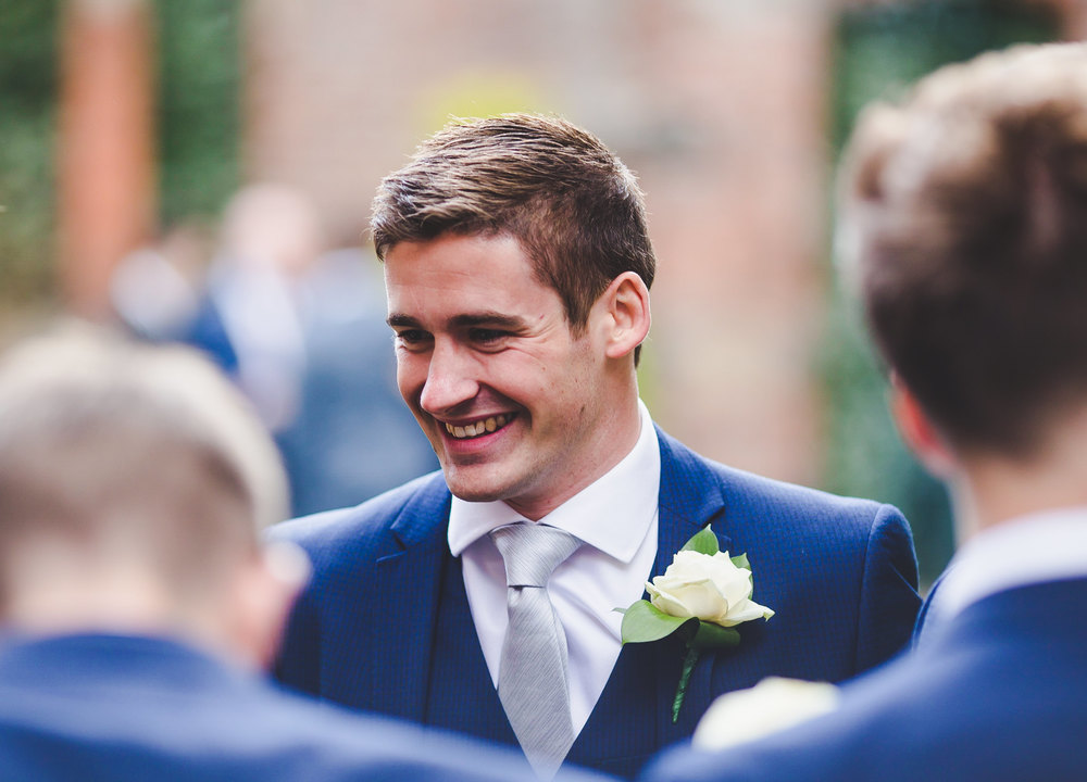 One of the wedding guests smiling. Gorton Monastery wedding
