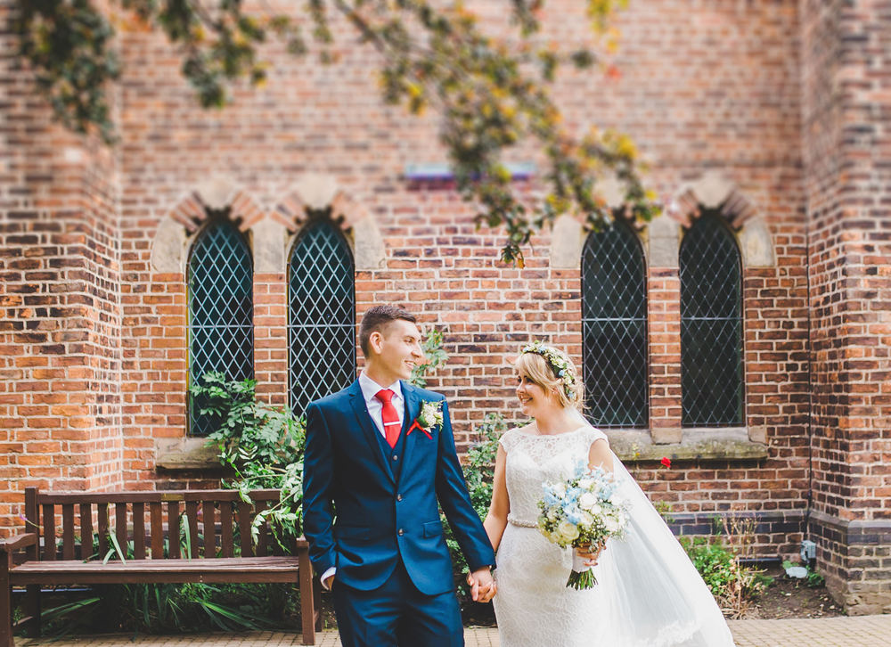 The bride and groom at The Gorton Monastery in Manchester for their wedding.