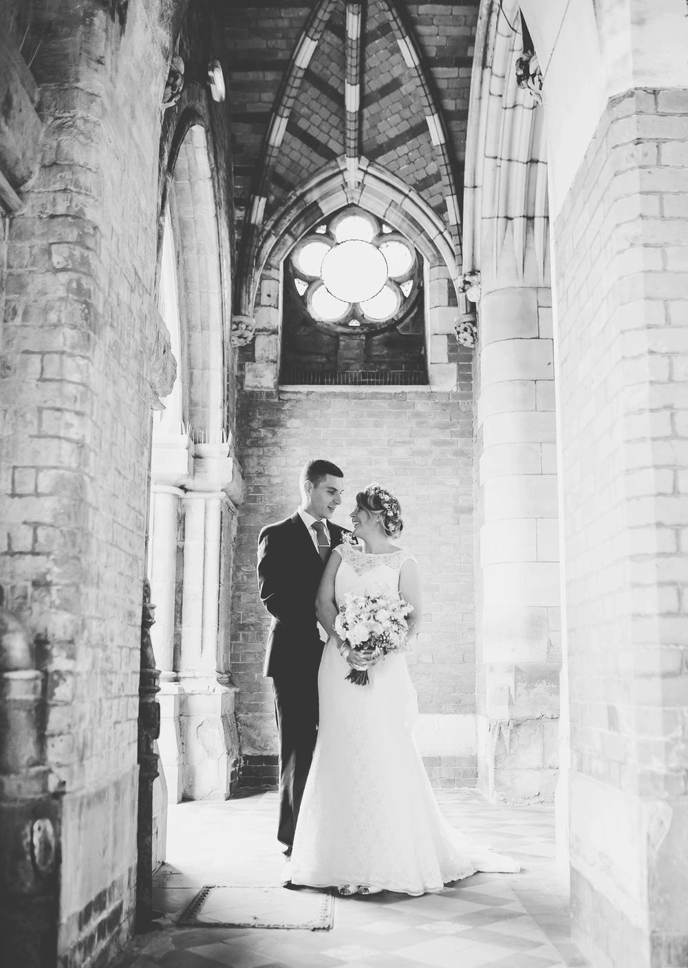 Black and white photograph, the bride and groom in the Gorton Monastery.