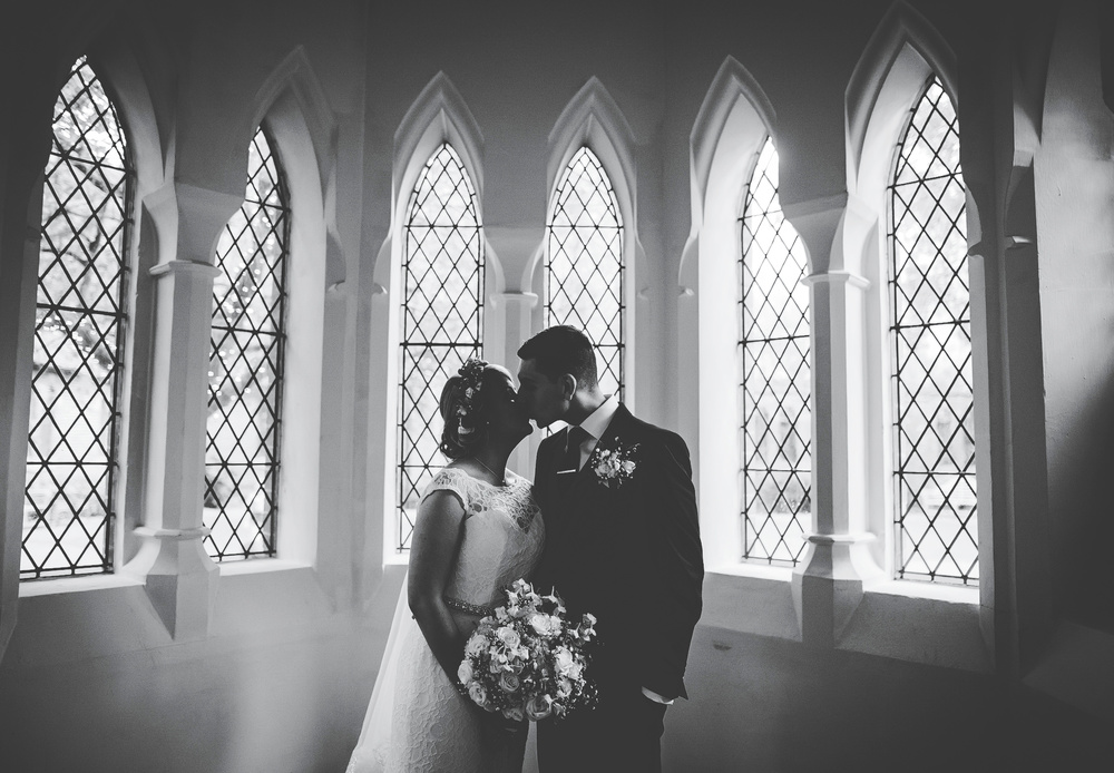 Black and white photograph of the bride and groom.