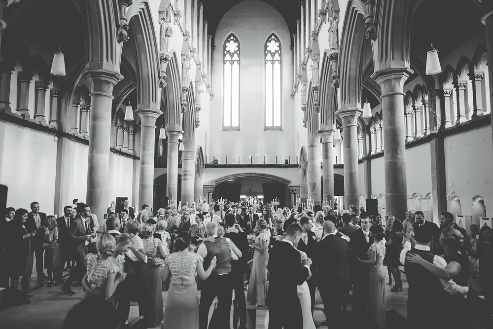 All of the wedding guests on the dance floor-Gorton Monastery for a beautiful wedding.