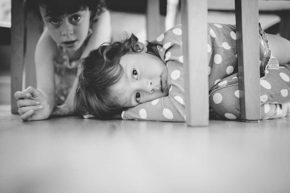 Children hiding under the table as the bride gets ready for her big day.