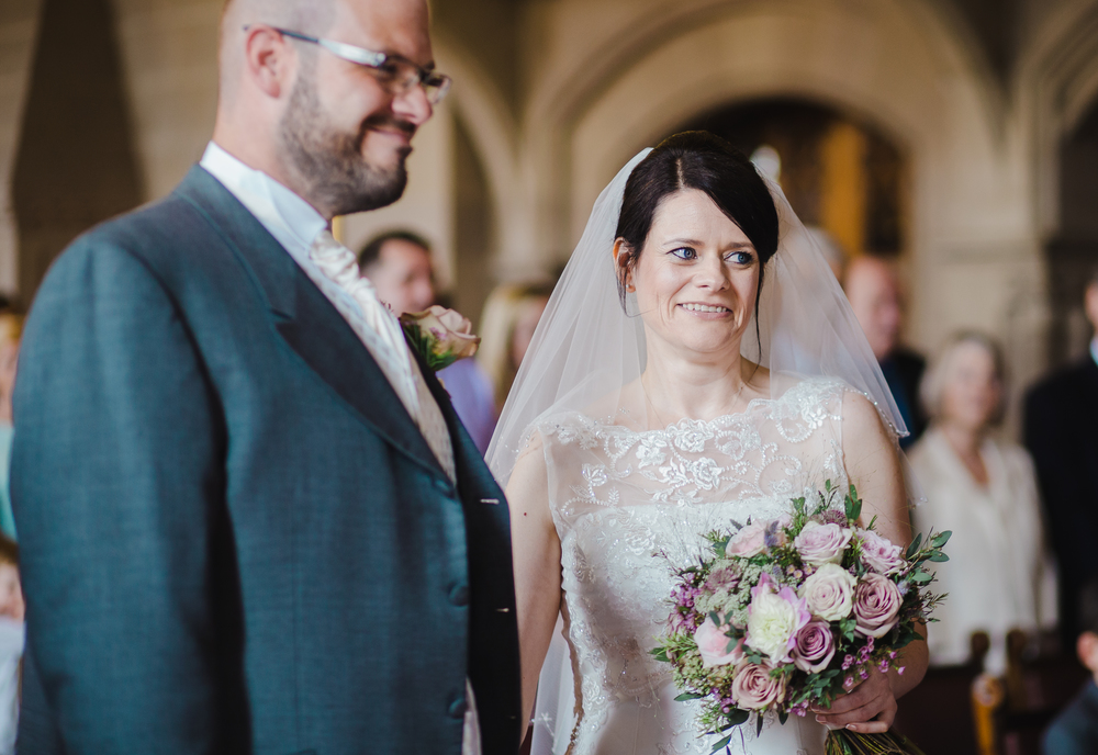 The bride and groom at the alter. Wedding photographer, Manchester.