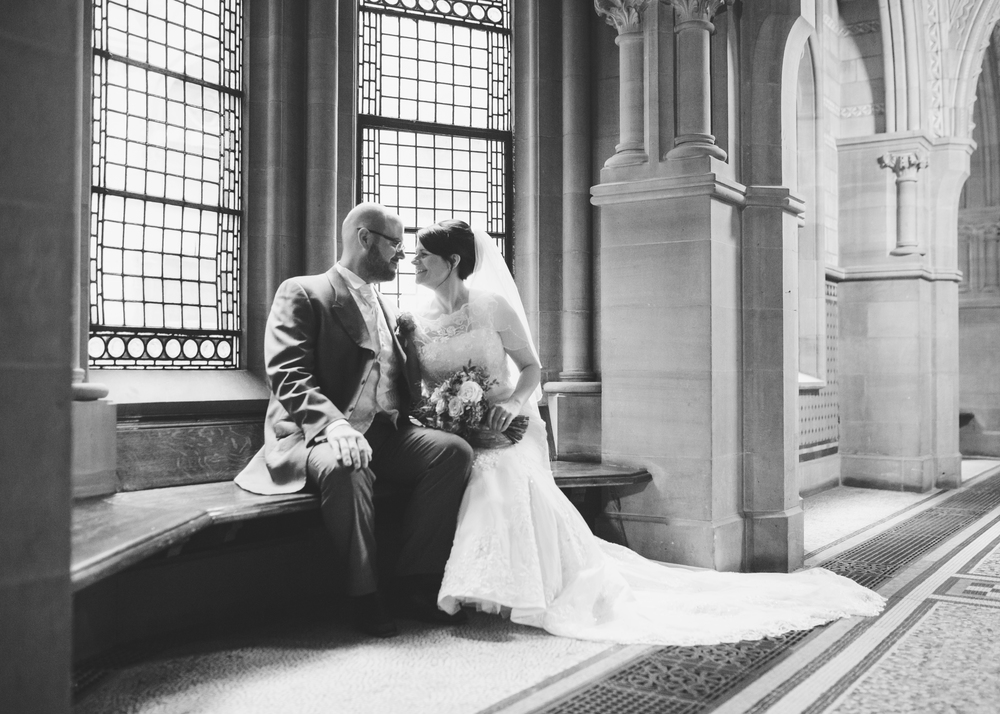 Black and white photograph of the groom with his bride.